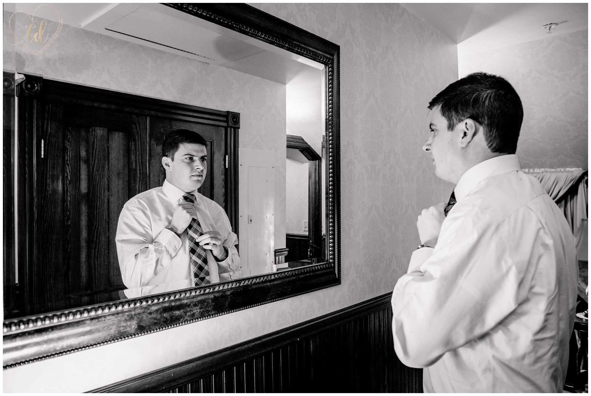 Groom getting ready for his wedding at the Berry Manor Inn