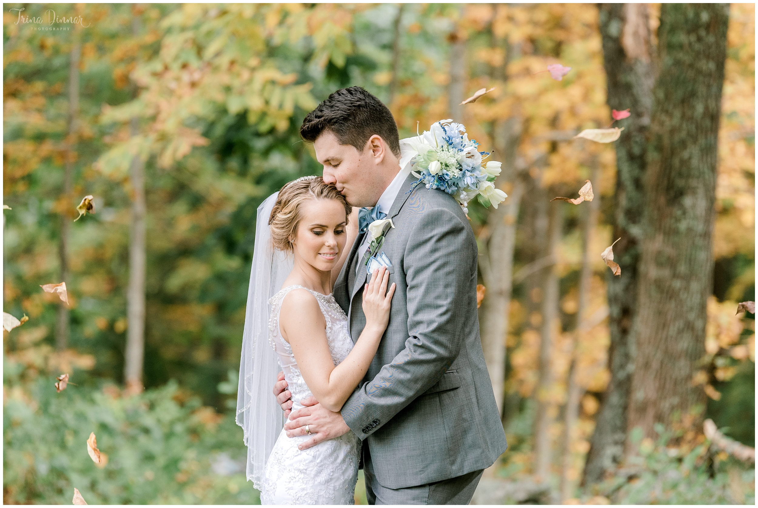 Maine Autumn October Wedding Couple Portrait with leaves falling
