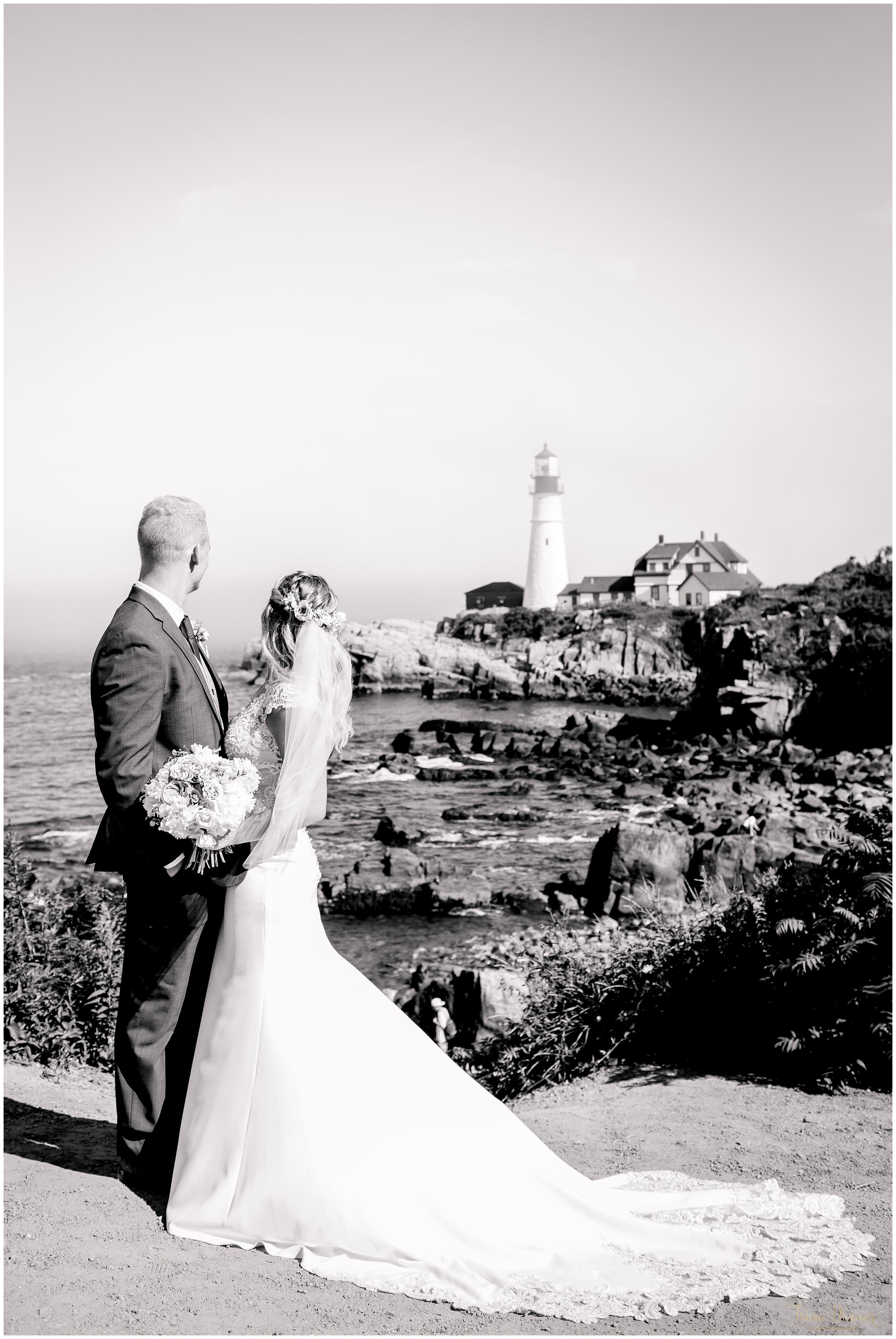 Cape Elizabeth Maine Wedding Scene with Bride and Groom looking at Portland Headlight