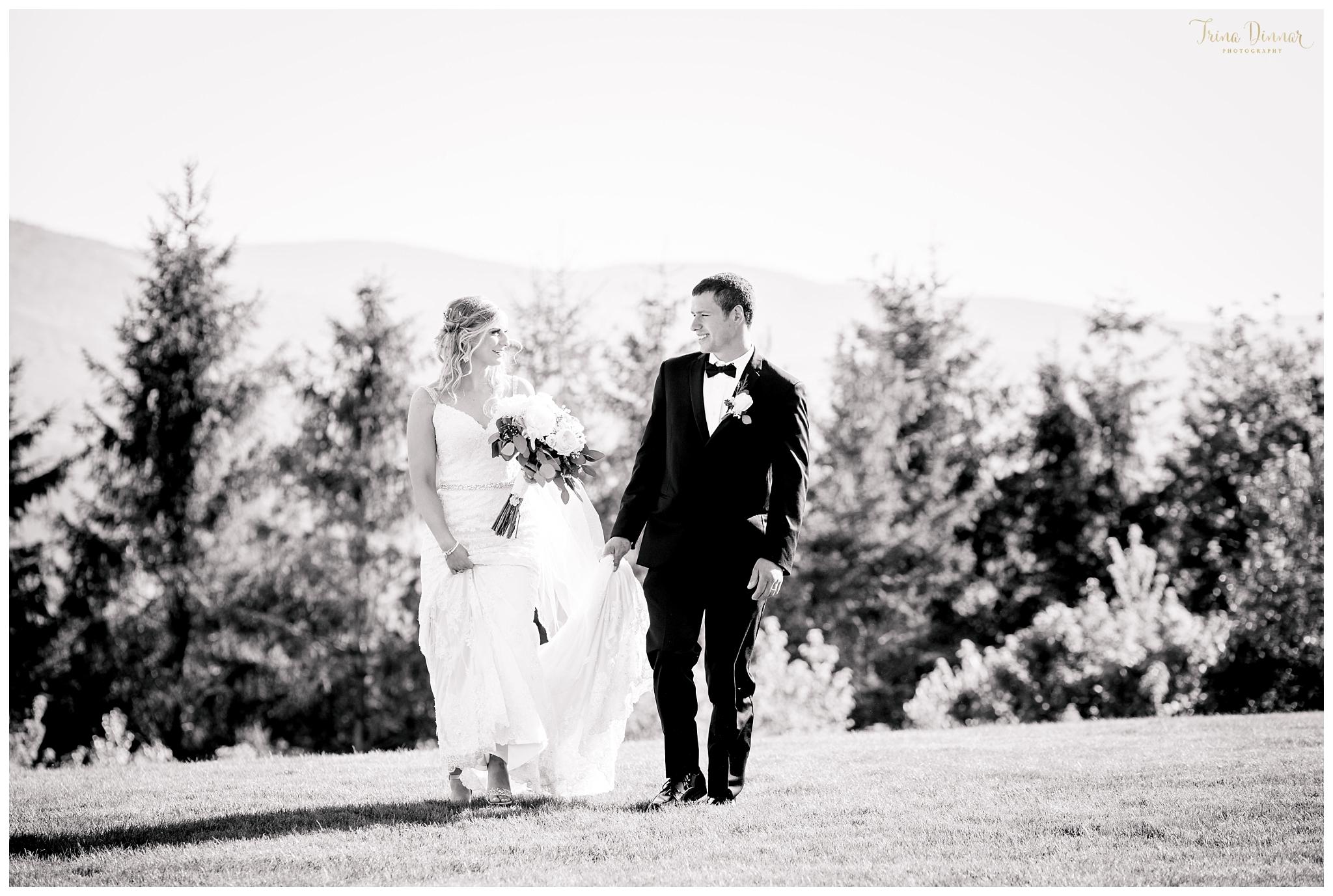 Couple walk together on wedding day