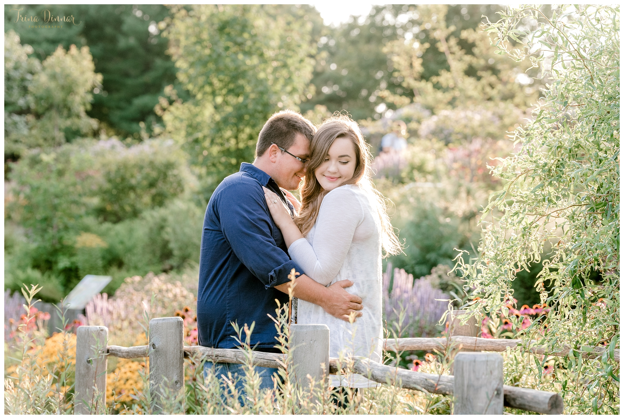 Maine Engagement Session in a Flower Garden at sunset
