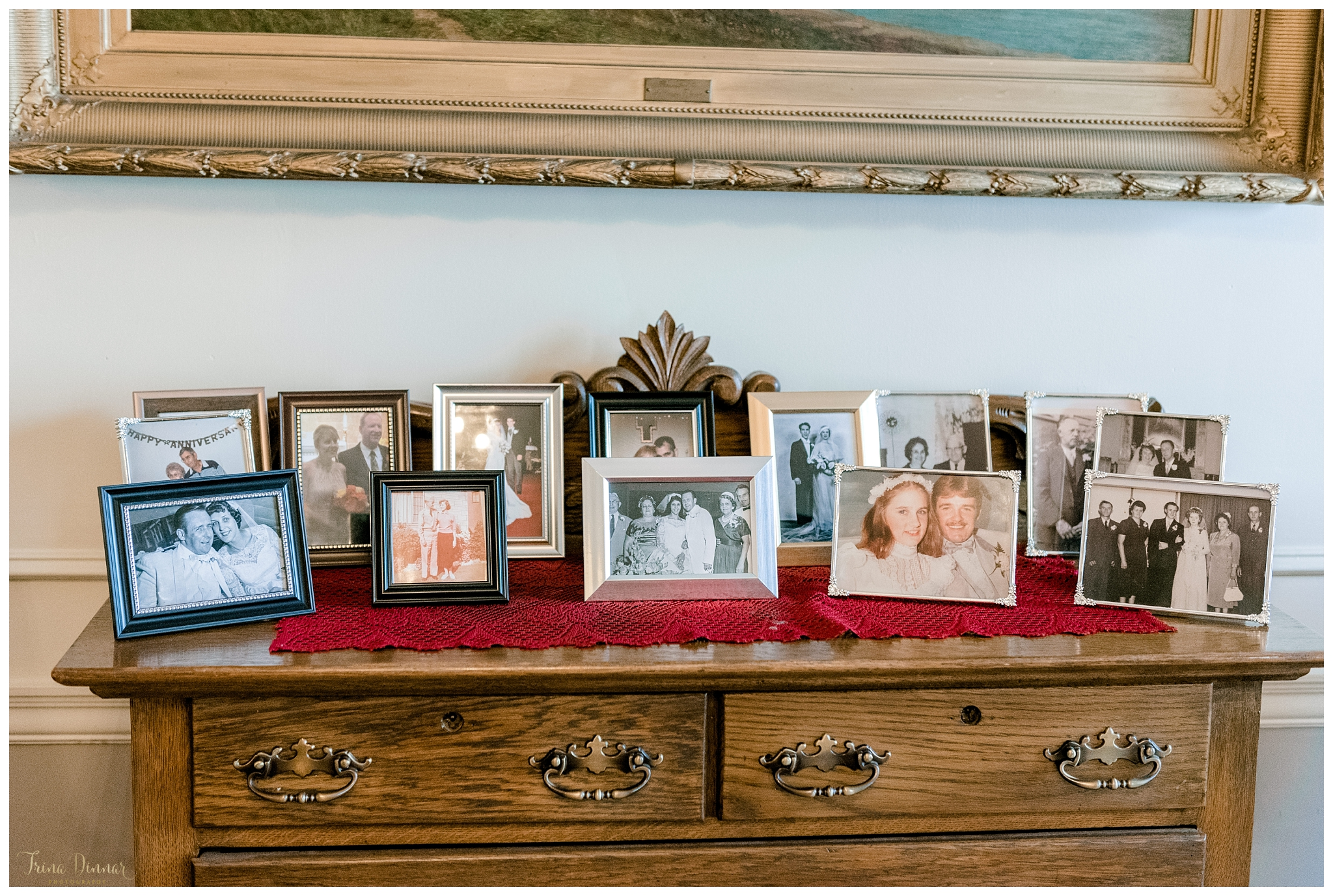 Old Framed Wedding Photographs on Display at Reception