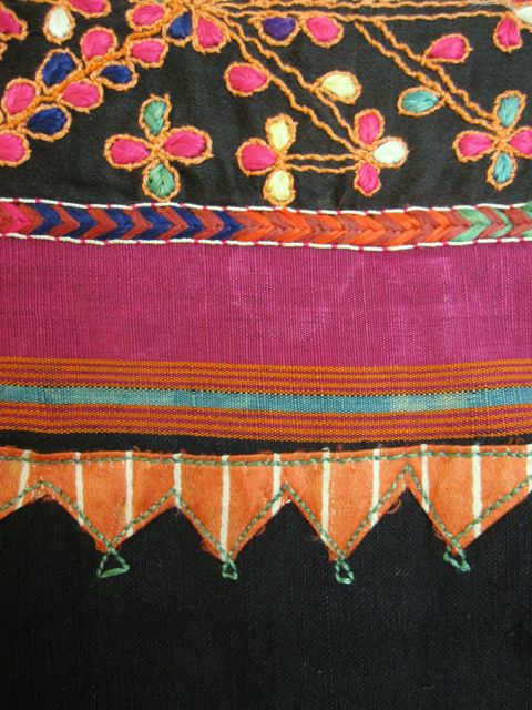 Rich detail of a Palestinian dress, with Syrian silk fabric appliqué.