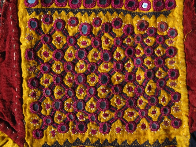 Sleeve fragment with mirror work embroidery from Kutch, Gujarat.