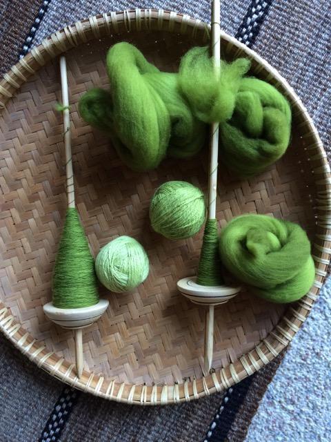 green handspun wool spindles