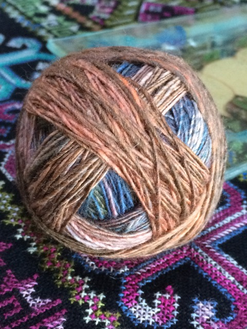 My handspun singles, wound in a ball to free a bobbin, and awaiting a second ply.