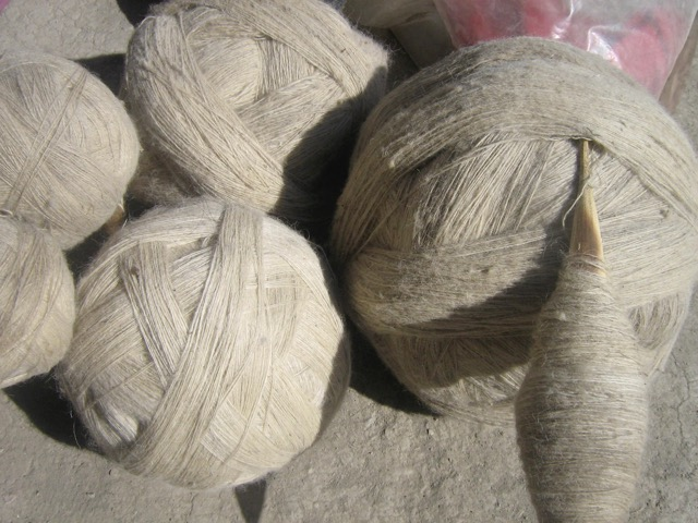 Handspun wool in Ladakh, India, wound into two-ply balls in courses, ready for plying.