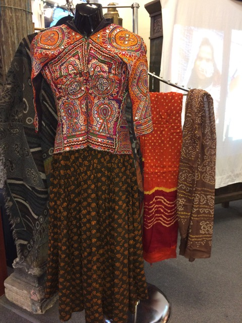 An exquisite embroidered festival top I bought in Bhuj in 1995, a block print skirt to go with it, and two  bandhani  scarves. Slide show in the background at Maestrale.