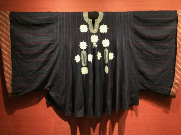 Nigerian robe, woven from narrow strips, in the collection of Leslie Grace as displayed at Aljoya Thornton Place