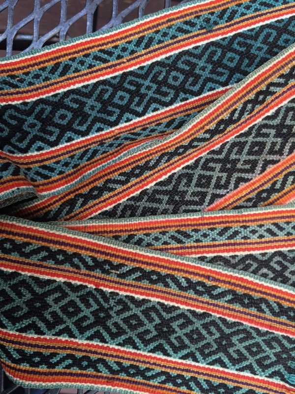 Warp faced band with complementary warp designs - where is it from?