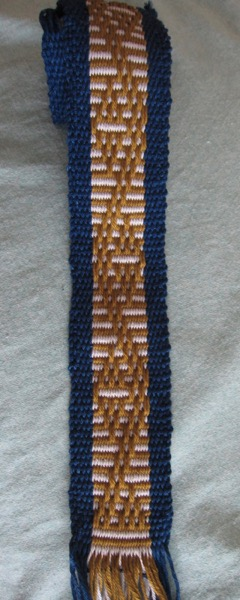 Sample with striped (plain weave) background.