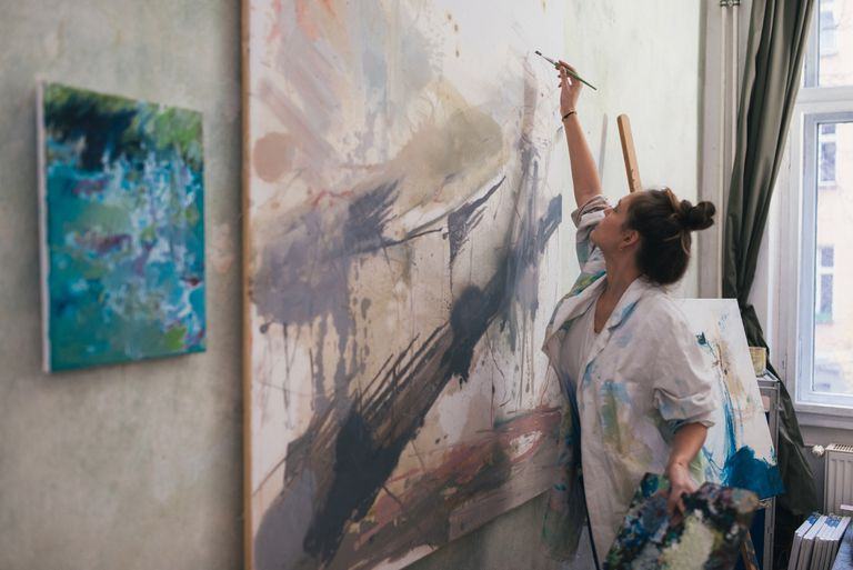 woman-painting-a-big-work-in-studio--893676154-5ad11467a474be0036384fce.jpg