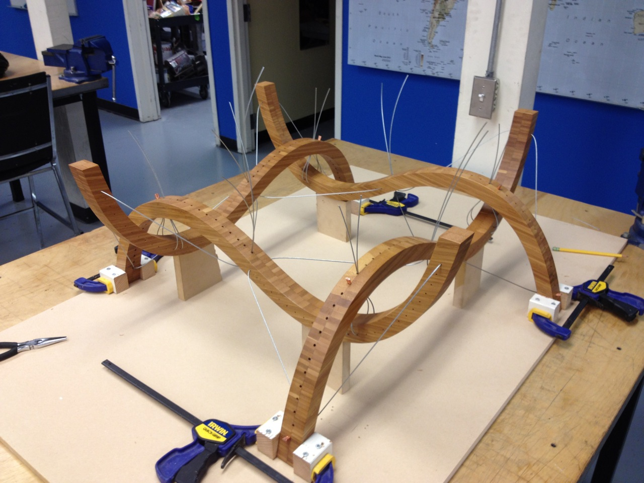 After receiving a thin layer of polyurethane, the curves are placed in a jig and wiring commences.