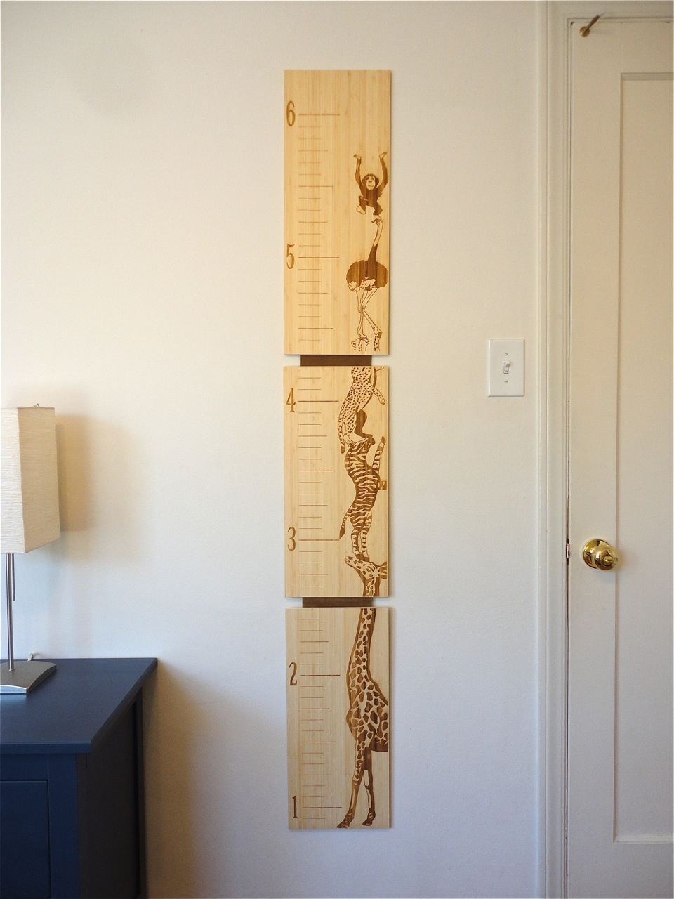 Bamboo growth chart for kids by robby cuthbert. Laser etched with the option of customizing by adding your child's name! This design features stacked animals with the topmost monkey holding you kid's name!