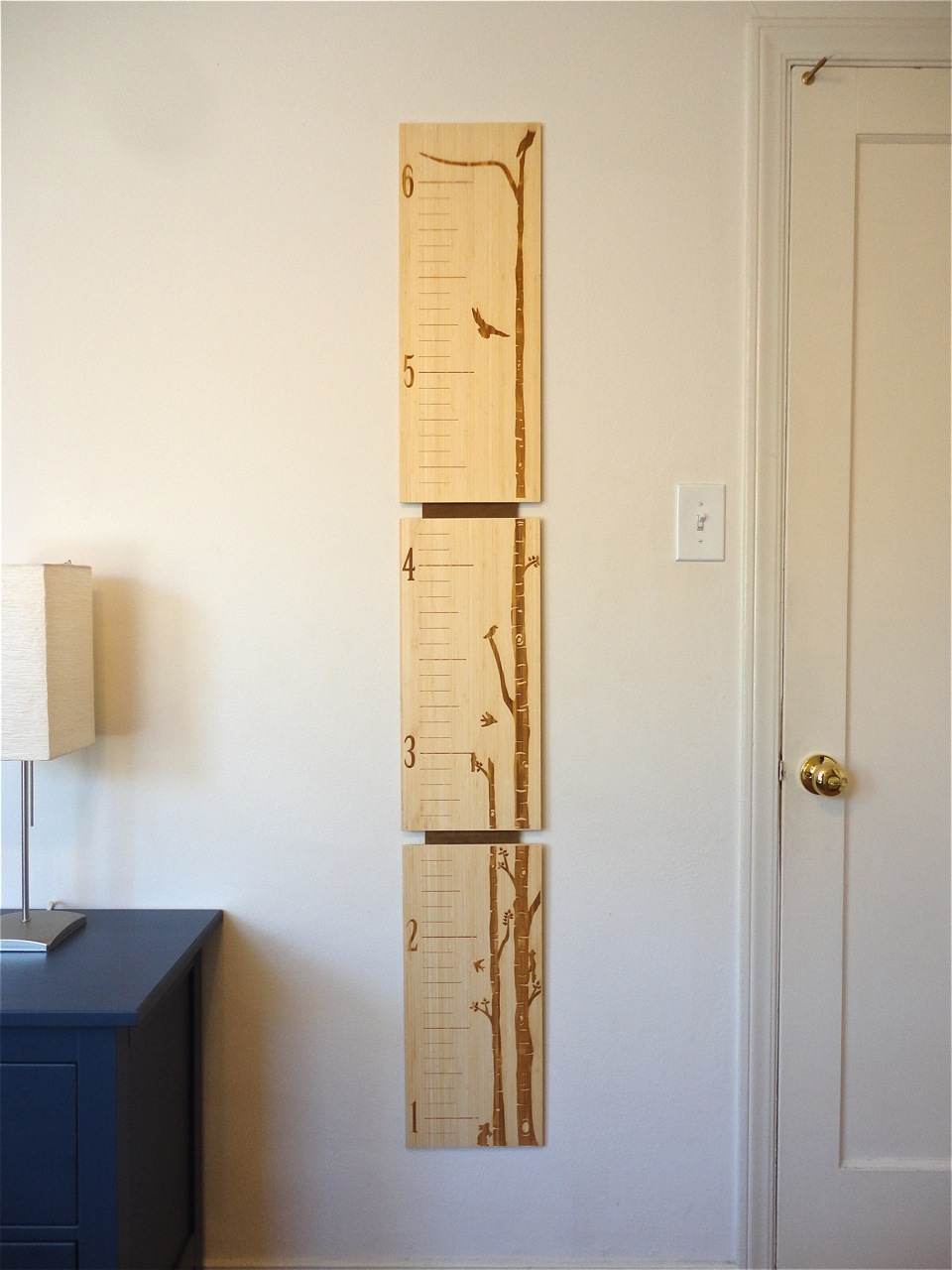 Bamboo growth chart for kids by robby cuthbert. Laser etched with the option of customizing by adding your child's name! This design features a birch tree forest with woodland creatures.