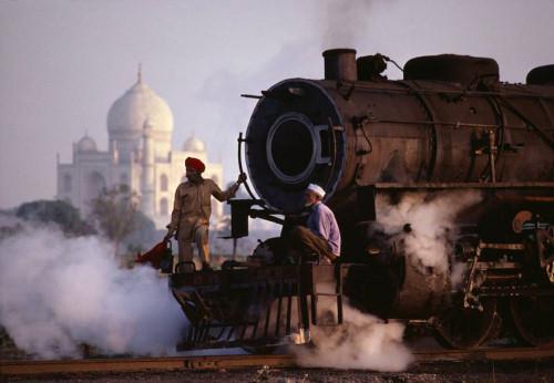 Two men on steam train in India. <http://www.smashingmagazine.com/2010/03/20/the-beauty-of-india-50-amazing-photos/>