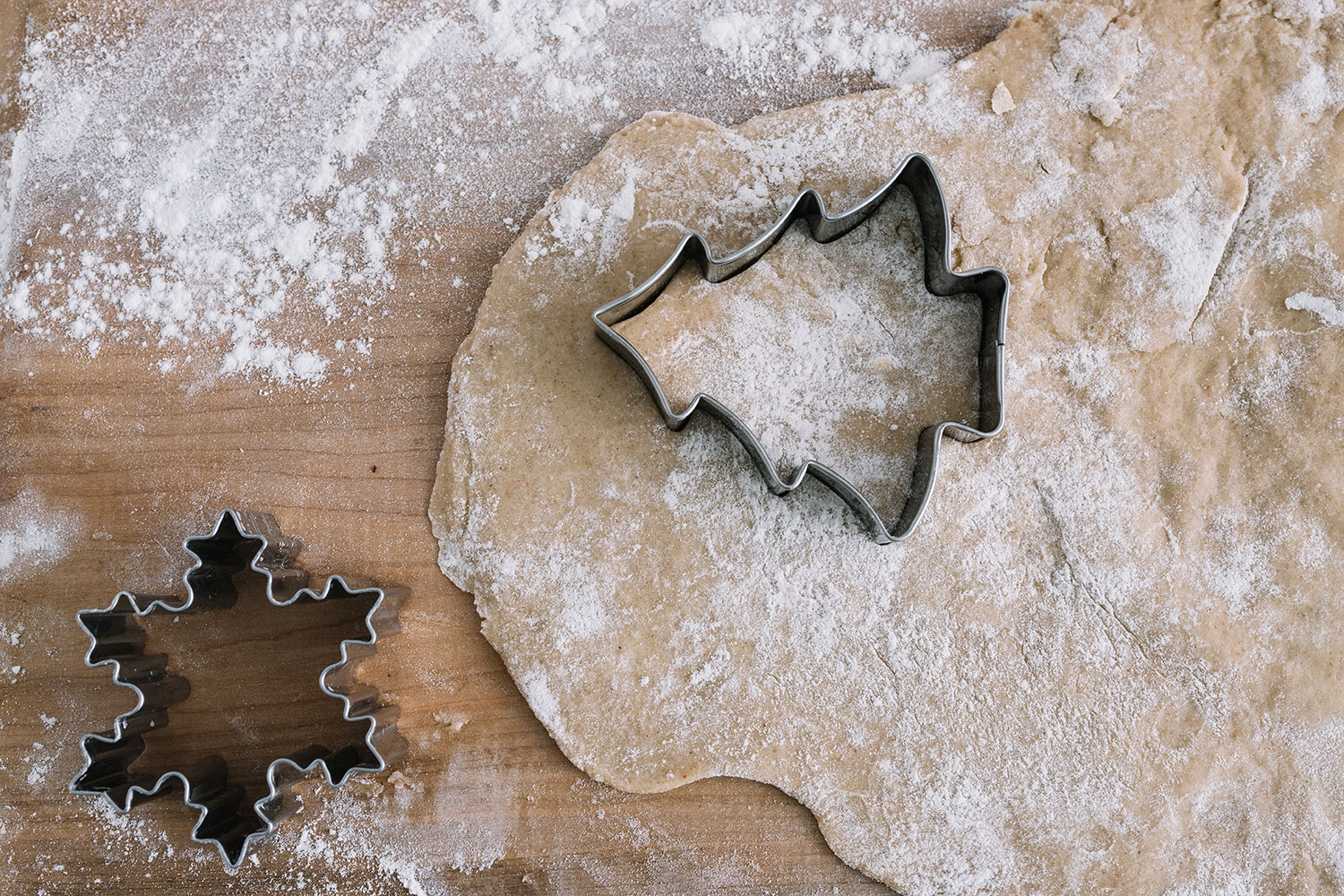 holiday cookie cutters on dough
