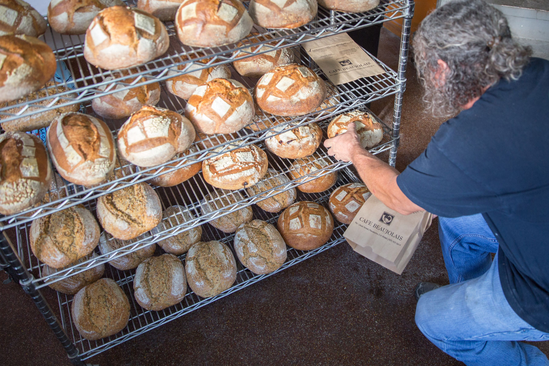 Mike inspects his loaves.