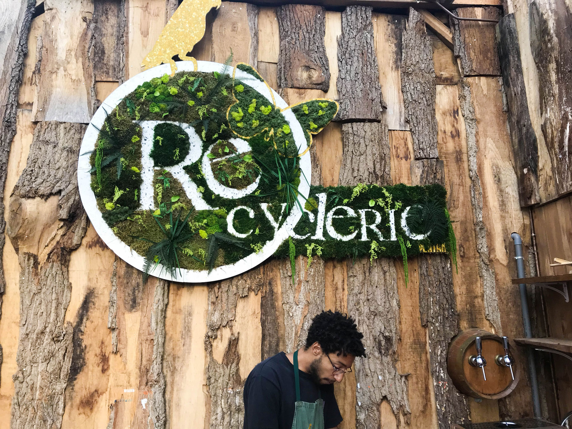 beautiful sign created by plants at Le REcyclery in Paris