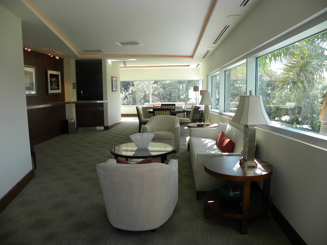 Founders Lounge - Private lounge with a bar and an outdoor balcony.