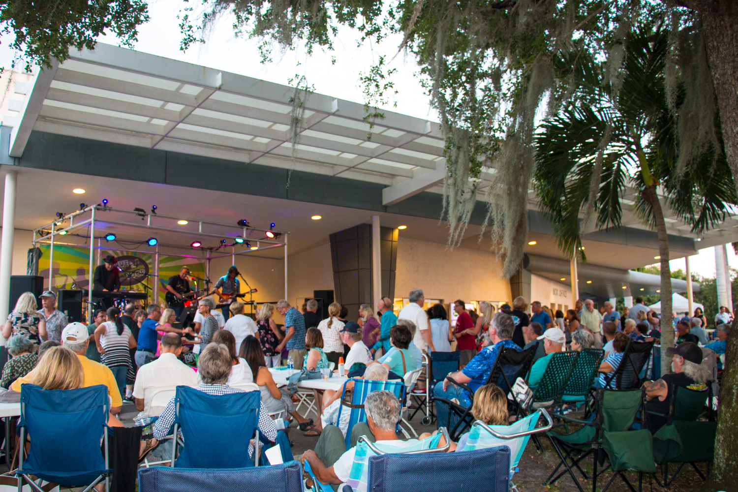 Live in the Loop - Our outdoor concert venue has tables and chairs for over 200 guests. The area also includes a walk-up window bar and grill.