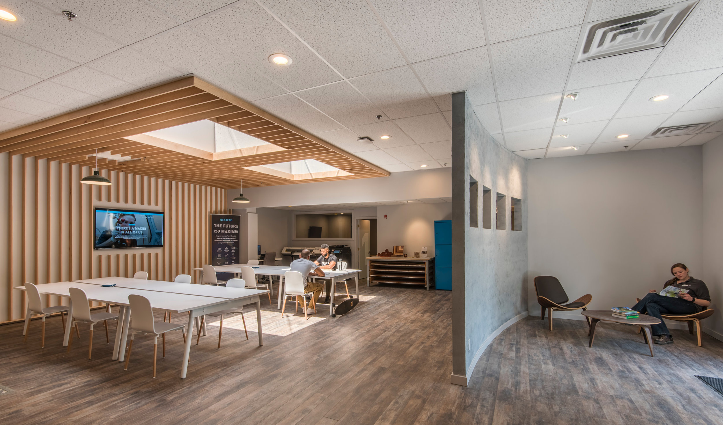 Reception area and coworking space. Photo credit: NextFab