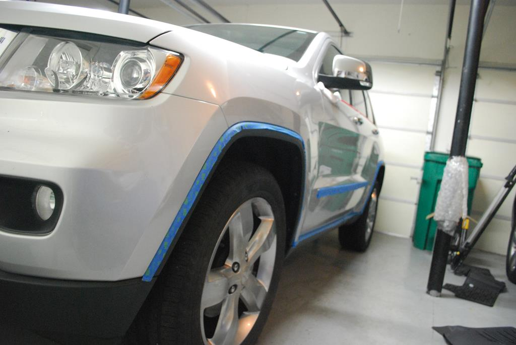 Taping to avoid getting polish on plastics and in crevices.