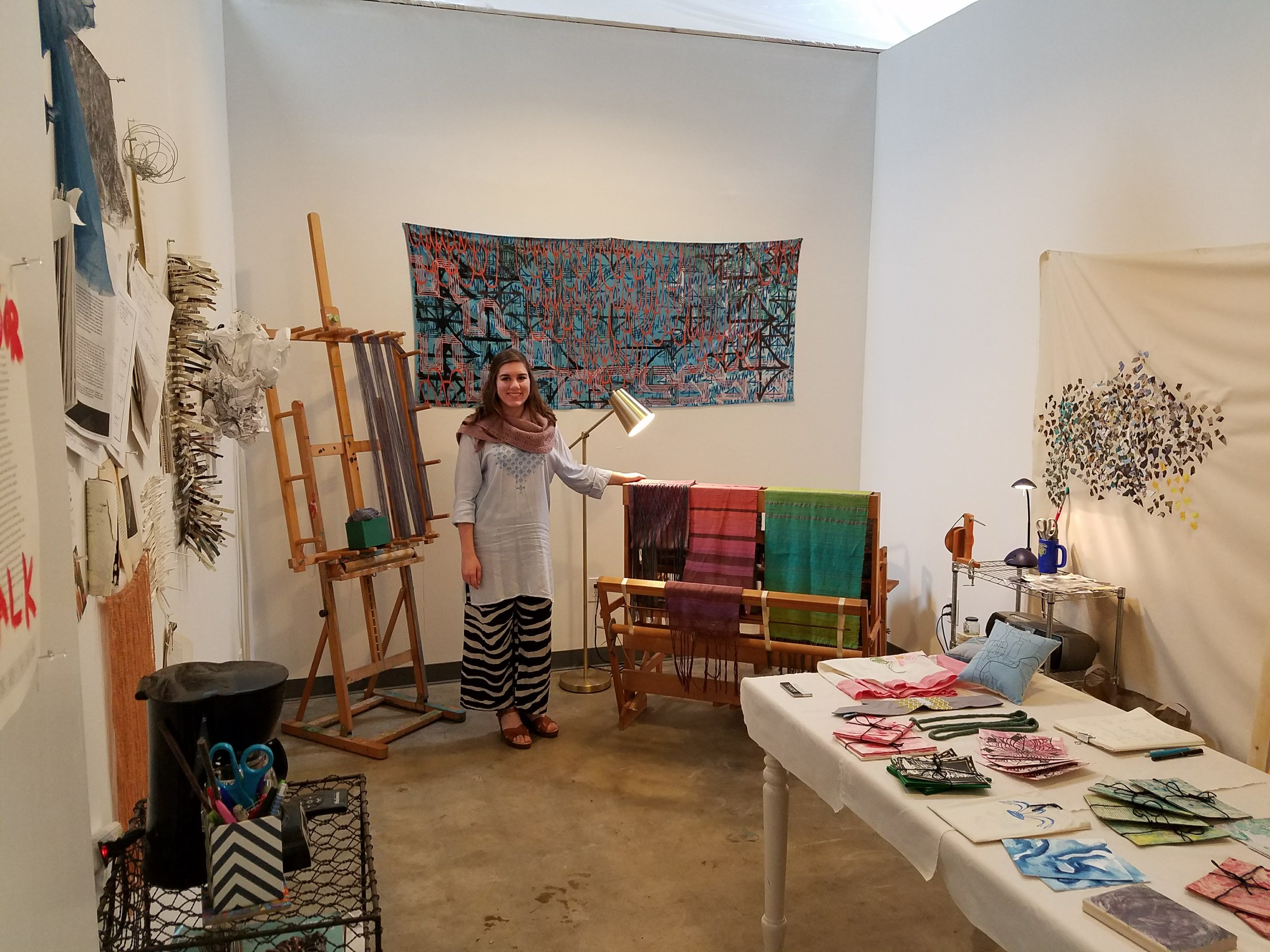 This is me in my studio, ready for the Open Studios event at Hawthorne Arts Complex earlier this month. I sold the two scarves on the left side of the loom, and have completed one more since then.