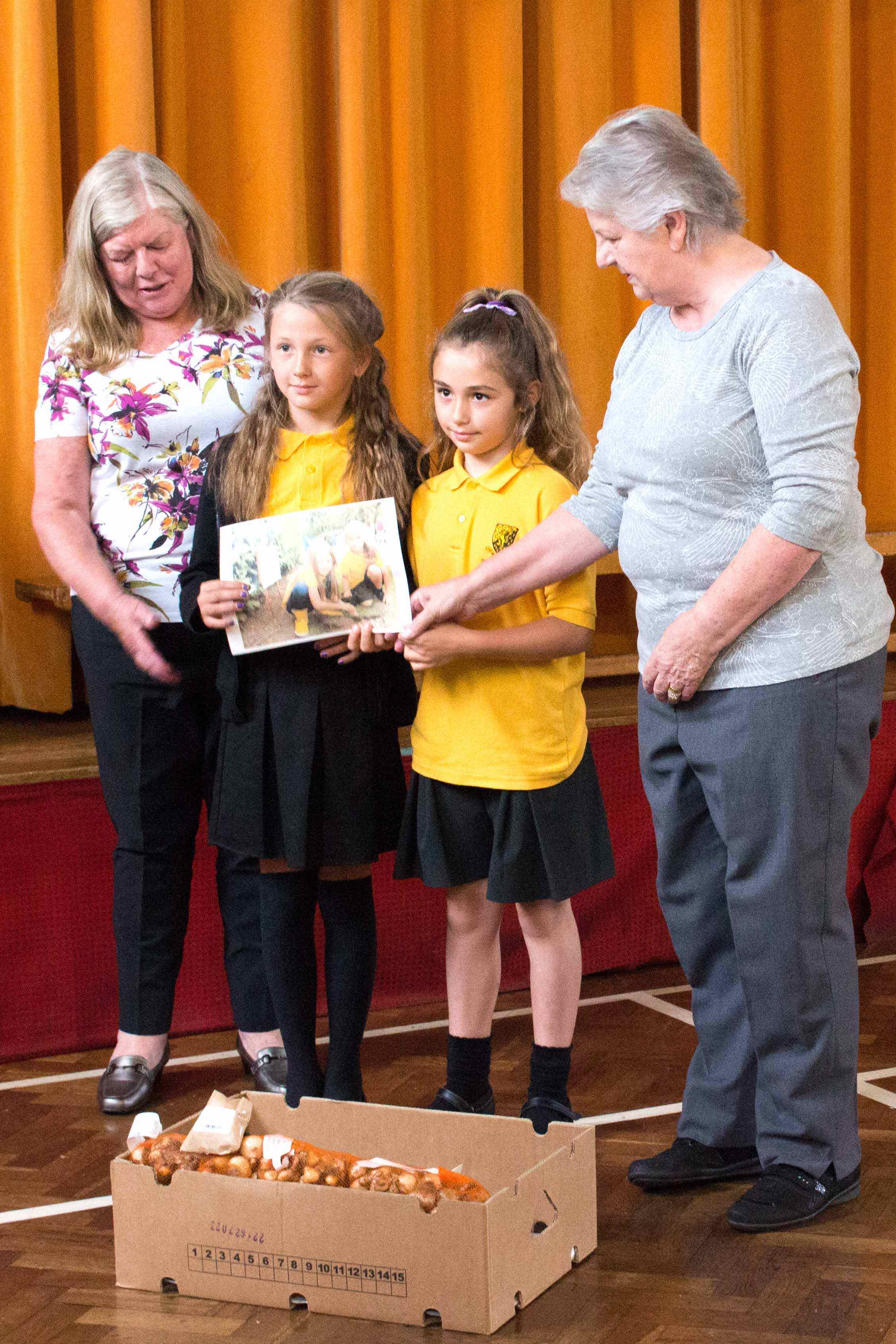 Pictured with the Head Teacher, Mrs Pritchard, and holding the winning photograph the starring girls!