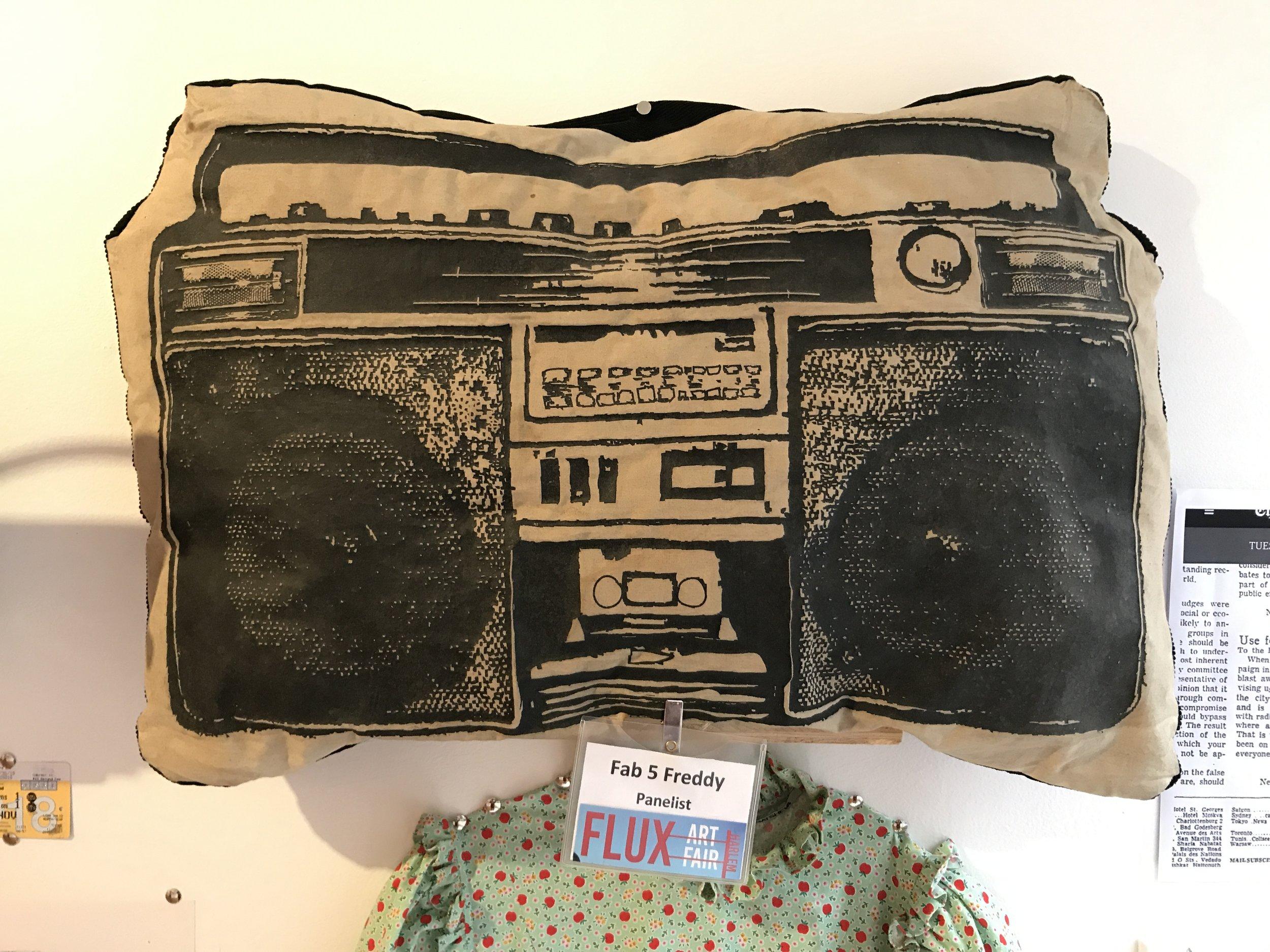 Boombox pillow + Art in Flux badge (Fab 5 Freddy, Artist)
