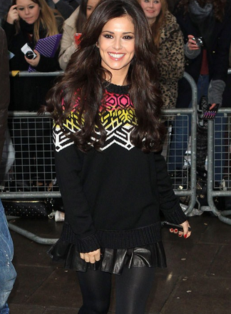 Cheryl Cole wearing her statement jumper on the red carpet.