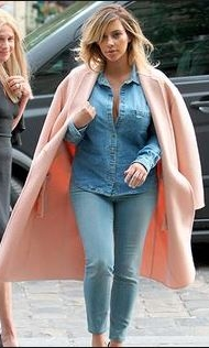 Kim Kardashian pairs her pink pastel coat with double denim