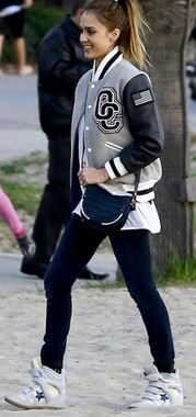 Jessica Alba pairing hers with jeggings, cross the body navy bag and converse white trainers- a great casual day look
