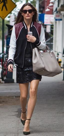 Olivia Palmero styling her bomber jacket with a leather mini skirt and over-sized bag for a smarter style