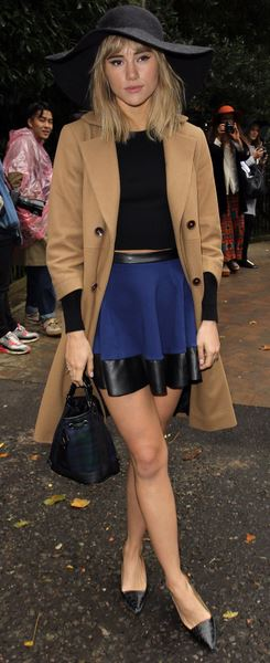 Suki Waterhouse at London Fashion week styling her came coat with a leather trimmed mini skirt and top- a great look for evening occasions.