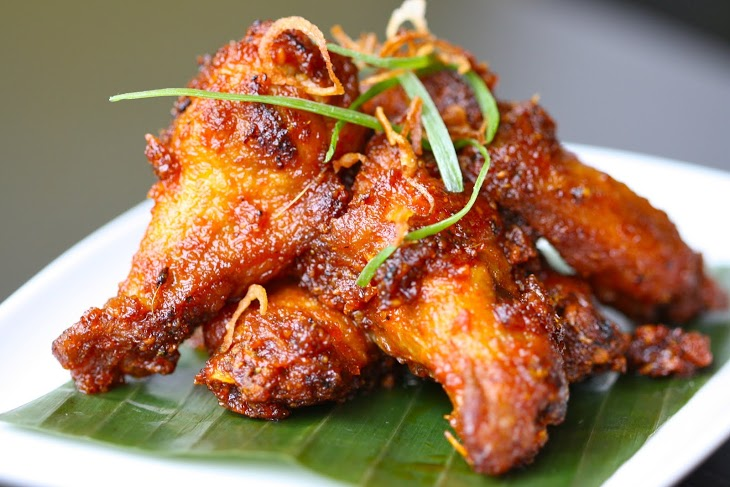 Red Chili Wings   sticky wings tossed with shallots, peanut, fennel, sweet chili  Photo Credit: Caroline Aksich