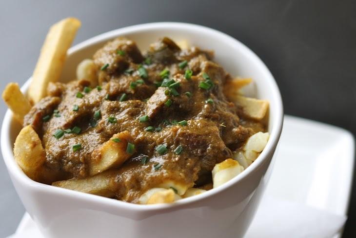 Rendang Beef Poutine   hand cut fries, lemongrass, curry leaf, rendang gravy, quebec cheese curds  Photo Credit: Caroline Aksich