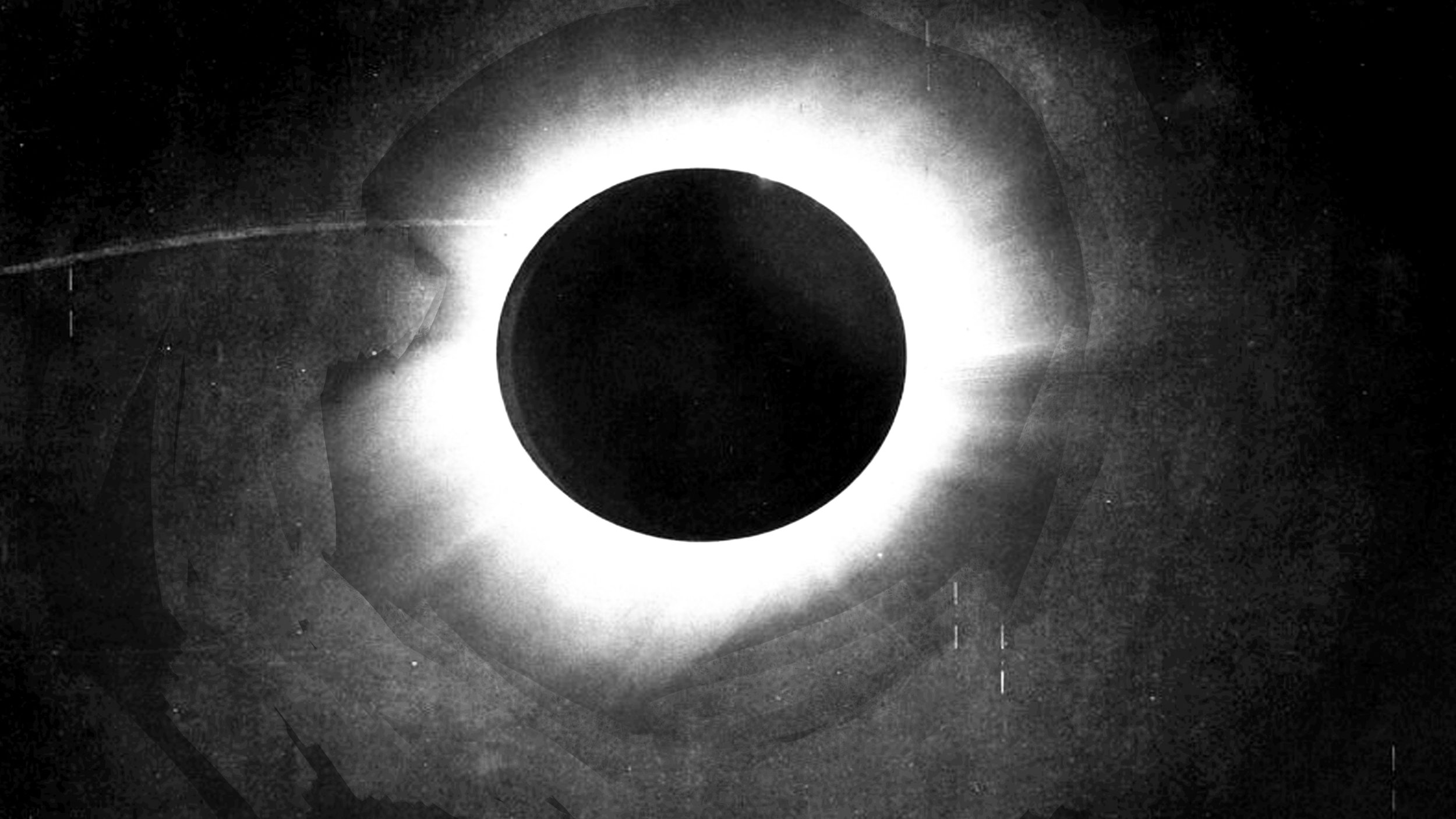 EXT. Outer Space The TZ logo dissolves to show the Sun being eclipsed by the moon.