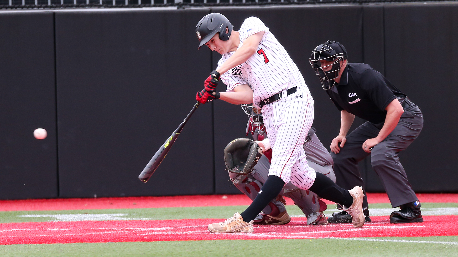 Ian Fair batting for the Northeastern Huskies.  Photo courtesy of Northeastern Athletics.