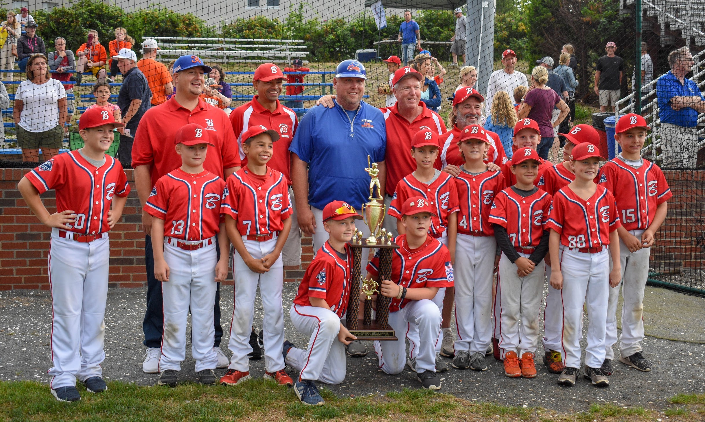 Now former Hyannis Harbor Hawk Manager Chad Gassman stands with Barnstable Little League players. Gassman announced his resignation on Friday to become the Athletic Director at Waldorf University in Iowa.  Photo Courtesy of the Hyannis Harbor Hawks.