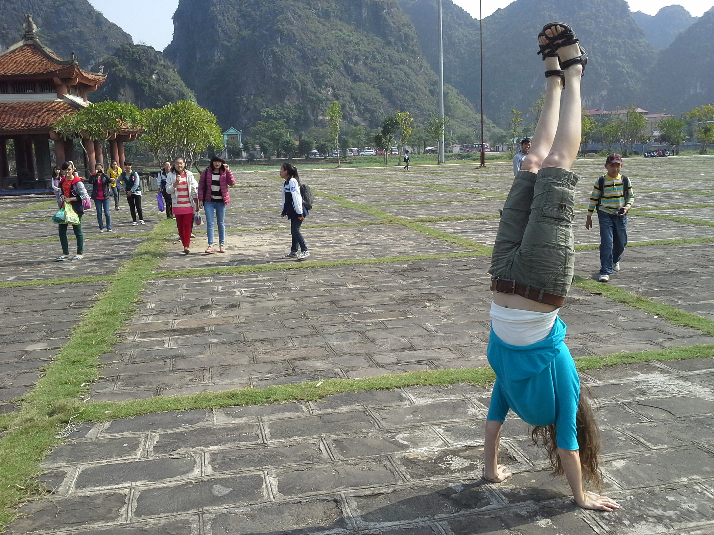 Being playful in Vietnam drew attention and interest of nearby school children.