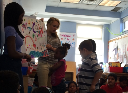 Here's a group of LitCampers at Morning Meeting presenting the flag of a new country they made up - Water Candy World!