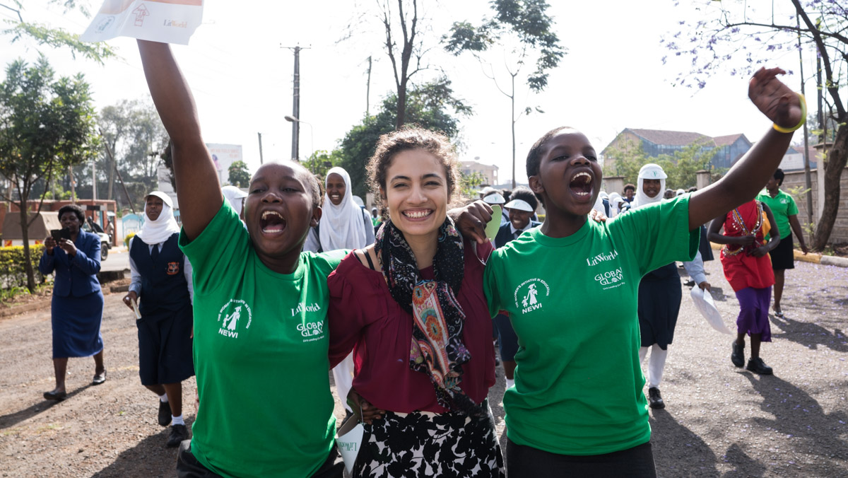 HerStory Director  Jennifer Estrada  marches with program participants at the conclusion of the National HerStory Summit in Kenya in 2016.