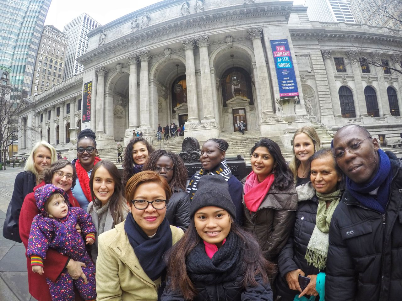 Staff, mentors, partnership coordinators and LitClub members from five organizations pose together outside of the New York Public Library.