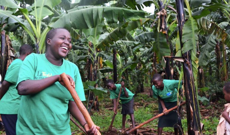 LitClub members in Rwanda participate in a community service project.