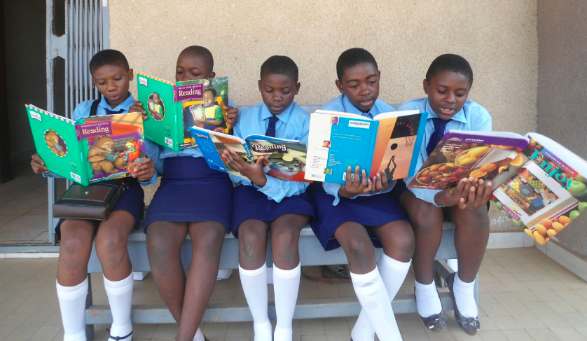 LitKids reading side by side in Cameroon.