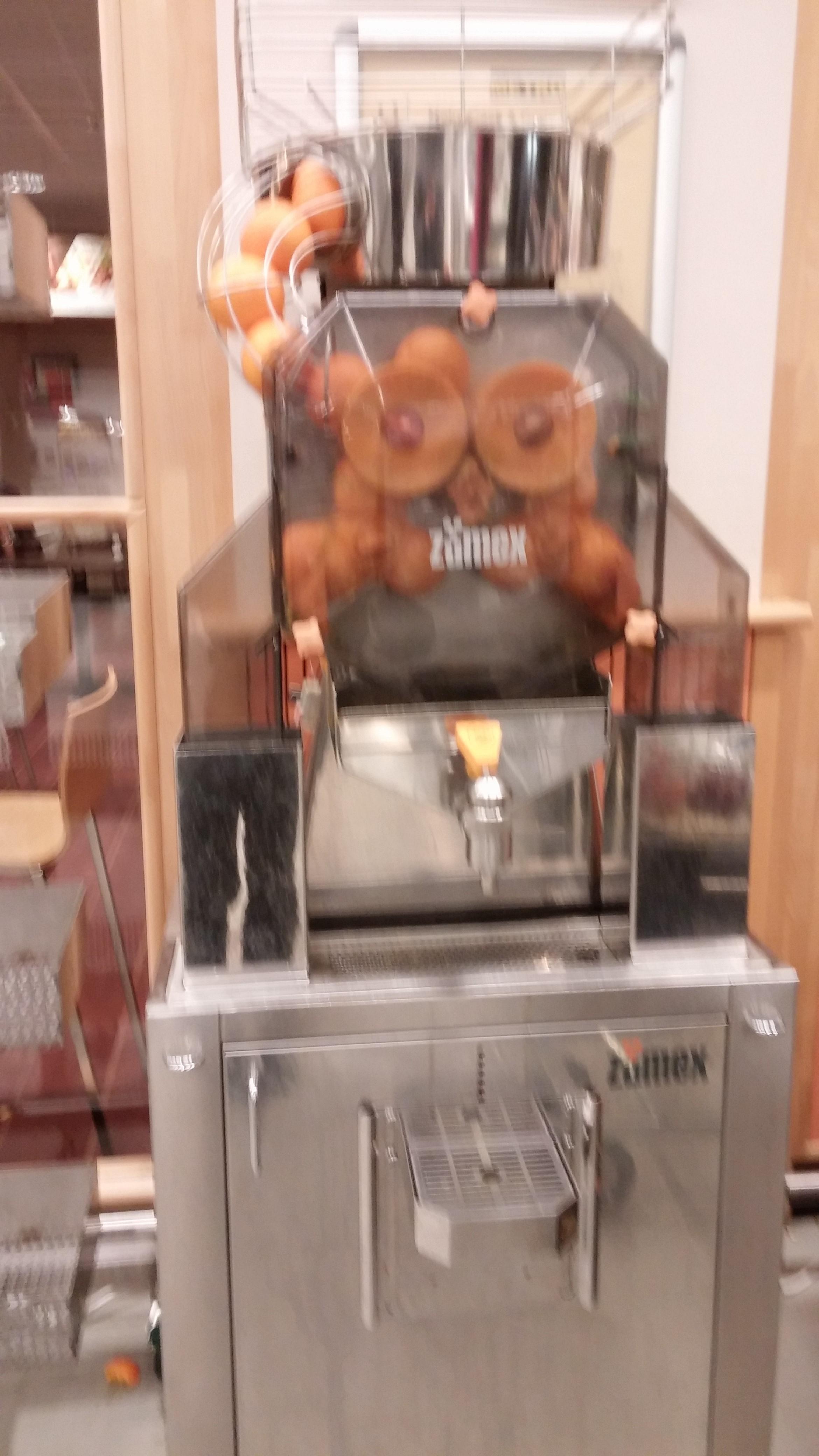 Orange juice machine (sorry it's blurry)