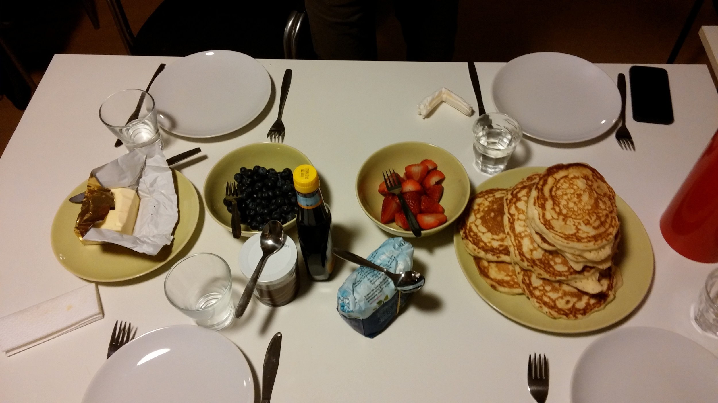 Served with butter, blueberries, strawberries, sugar, syrup, and nutella.