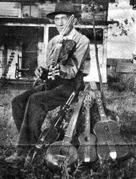 T.E. Hixson pictured with instruments he made.  Photo from article published in The Tennessean, no date is given on the clipping.