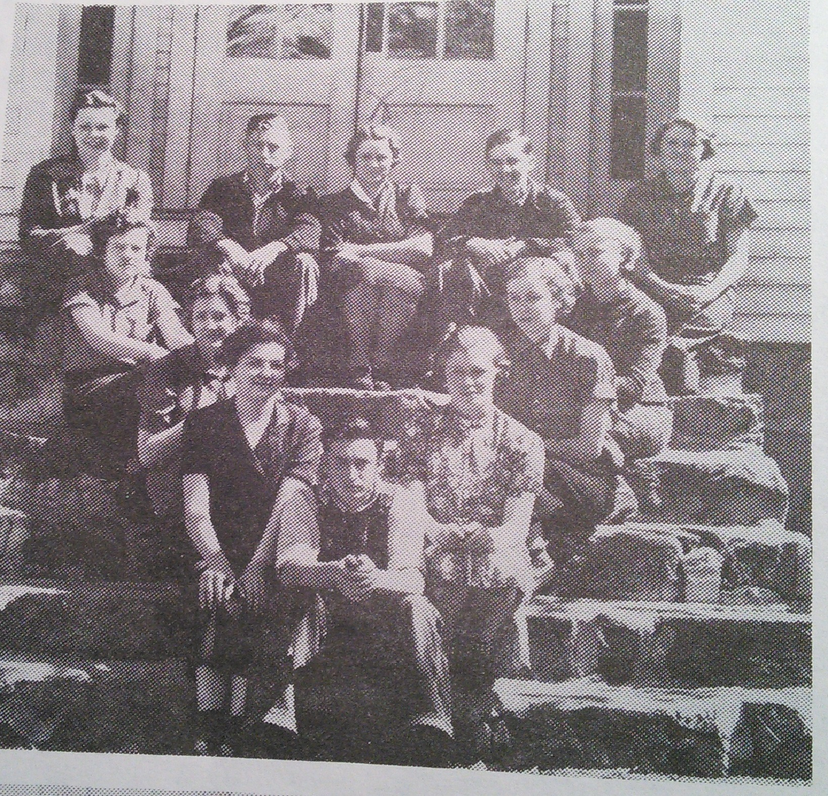 1938 Geometry Class Picture taken on the steps of the old high school building. Wasn't it a neat idea that they sat in a triangle since they were studying geometry?